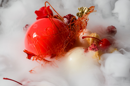 Dessert in steaming dry ice