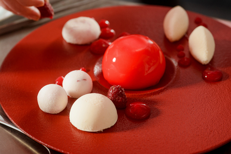 Raspberries and mousse cake