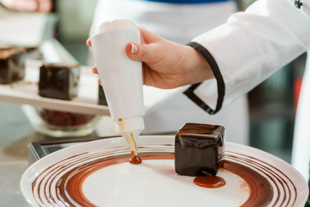 Decorating plate with berry sauce