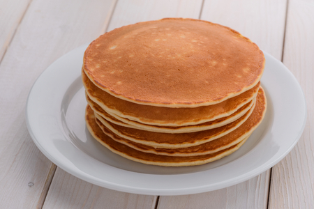 Piled pancakes on the plate Stock Photo