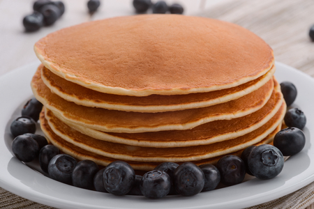 Blueberries and stacked thick pancakes