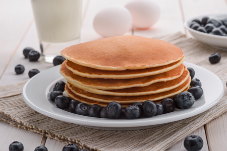 Piled pancakes with blueberries