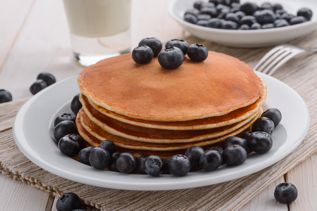 Stacked pancakes edged with blueberries