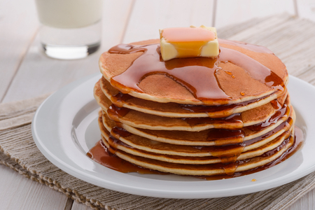 Hot pancakes under maple syrup