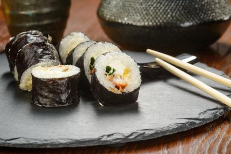 Chopsticks and tuna sushi rolls