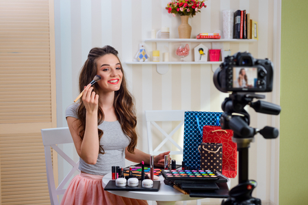 Applying powder with makeup brush Фото со стока