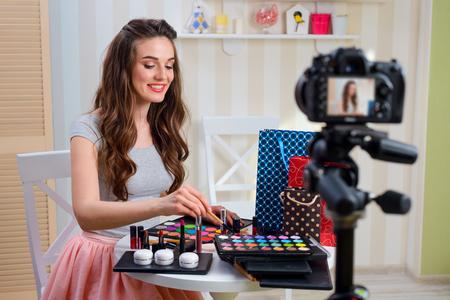 Beauty blogger recording makeup tutorial
