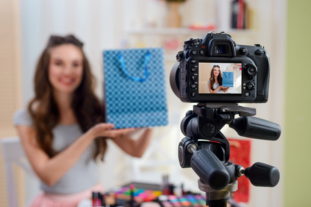 Beauty blogger holding paper bag