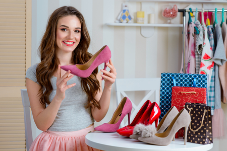 Female blogger represents fashionable shoes