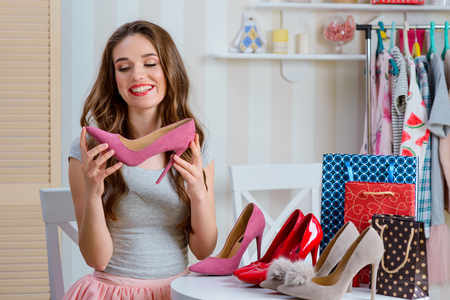 Female blogger admiring pink shoes