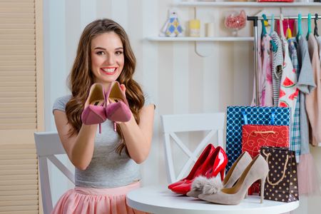 Fashion expert presents pink shoes
