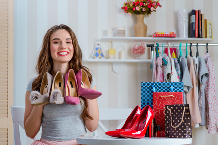 Beauty blogger holding pump shoes Stock Photo