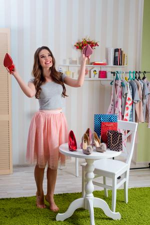 Blogger reviews new stilettos Stock Photo