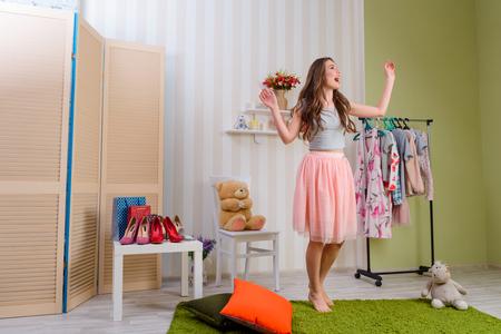 Beautiful girl singing at home