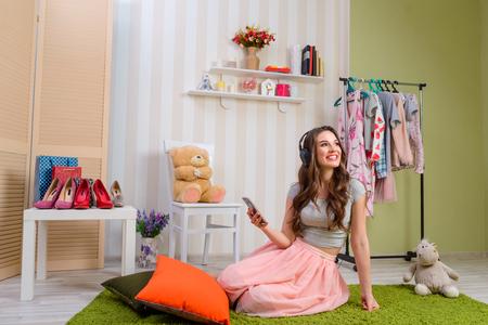 Female teenager listening to music