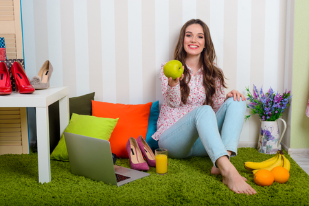Happy woman holds green apple