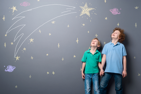 Two brothers gazing at stars Stock Photo