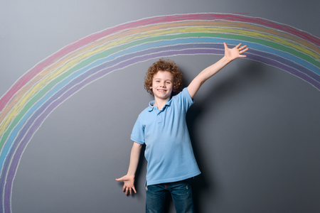 Happy boy and colorful rainbow