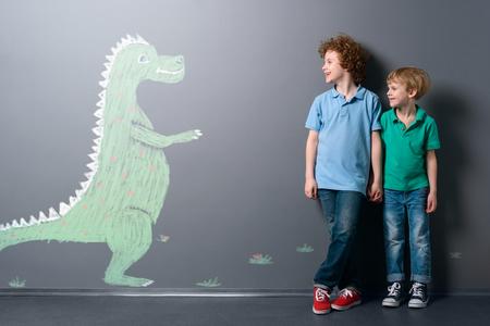 Cute dinosaur and two boys