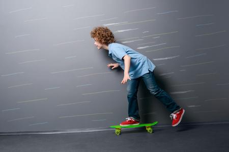 Little skateboarder is gaining speed Stock Photo