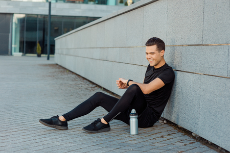 Man sitting on the ground Stock Photo