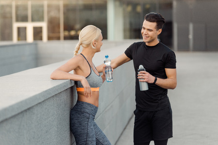 Friends talking and drinking water Stock Photo