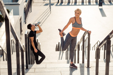 Couple preparing for running session Stock Photo