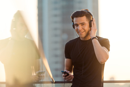 Happy sportsman listening to music