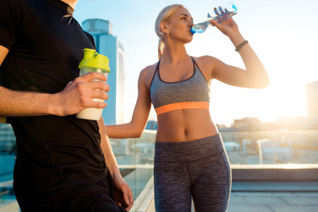 Fit woman is drinking water