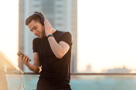 Man choosing song for running Stock Photo