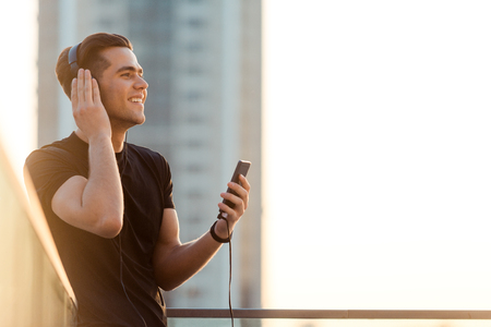 Joyous man listening to music
