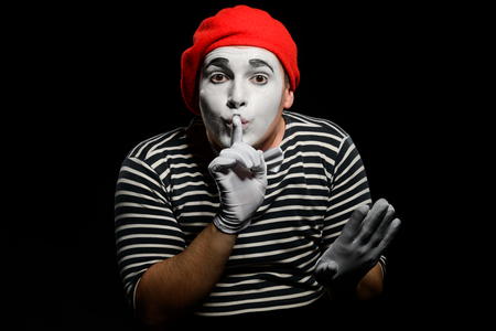Male mime showing silence sign