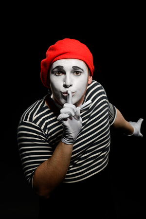 Male mime showing hush sign Stock Photo