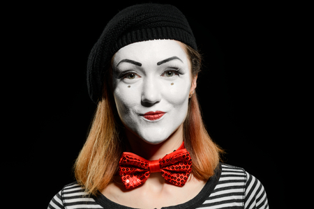 Cute female mime on black