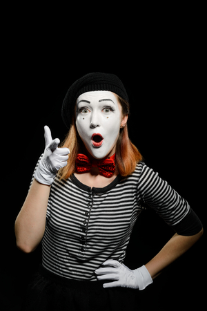 Female mime points at you