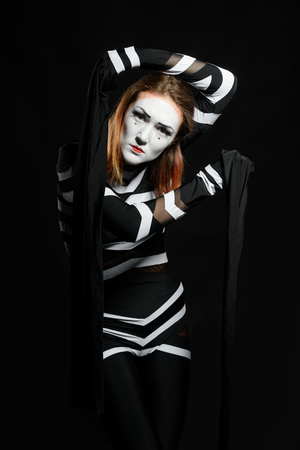 Woman as mime artist Stock Photo