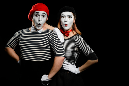 Surprised mimes, isolated on black