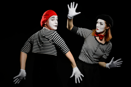 Two mimes and invisible wall Stock Photo - 110398387