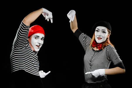 Mimes points at imaginary object