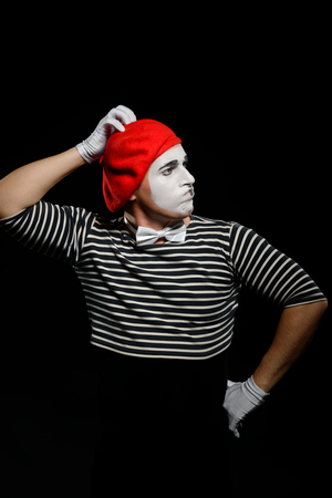 Mime thinking and touching head