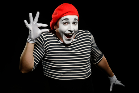 Male mime showing something small 스톡 콘텐츠