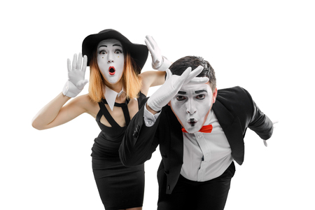 Amazed mimes on white background