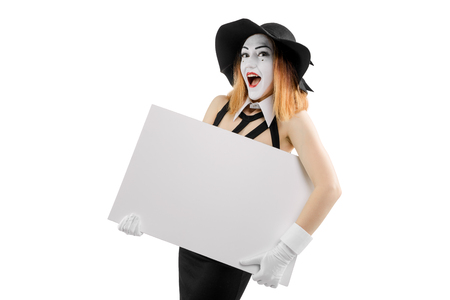 Happy female mime holding board