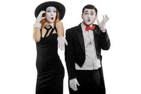 Two mimes talking on phone