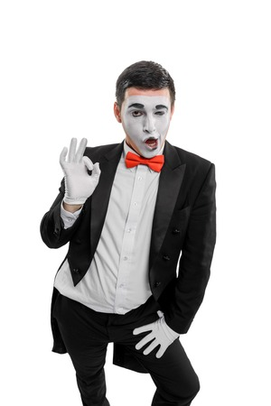 Male mime showing alright sign Stock Photo