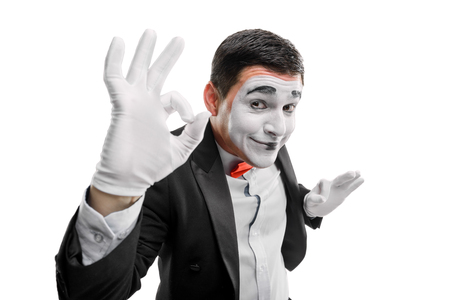 Mime actor showing OK sign