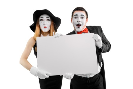 Mime actors holding blank placard Banque d'images - 110484569