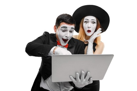 Mimes using a laptop Stock Photo
