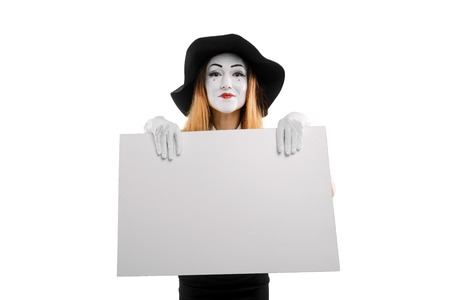 Smiling mime holding empty placard Stock Photo