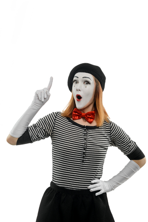 Female mime pointing finger up Stock Photo - 110485063